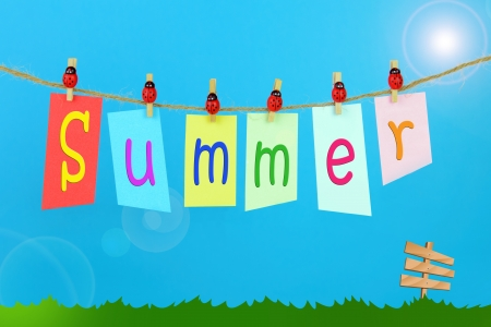 Hanging the word Summer on blue sky background photo