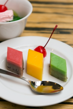 Assorted types of Malay colourful kuih and dessert