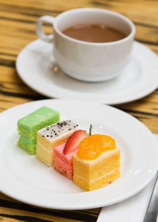 Assorted types of fruit cakes served in the plate