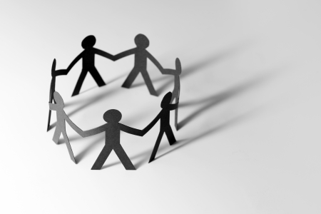 Teamwork concept with people holding hands in a circle photo