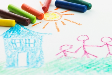 crayon: Kid drawing family near their house picture using crayons Stock Photo