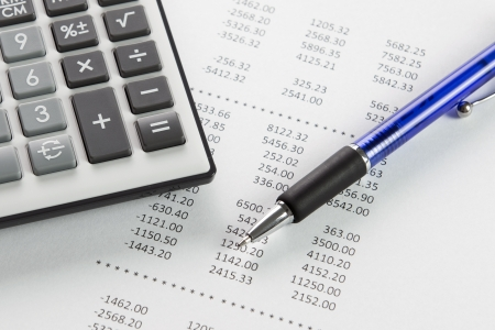 Finance analysis concept using finance report with pen and calculator Stock Photo