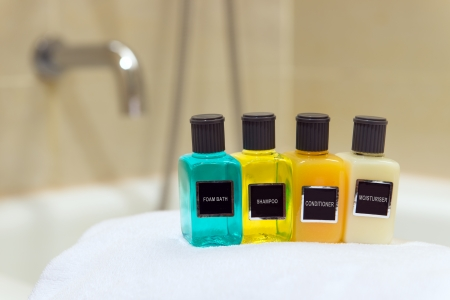 toiletries: Foam bath, shampoo, conditioner and moisturiser in hotel bathroom Stock Photo