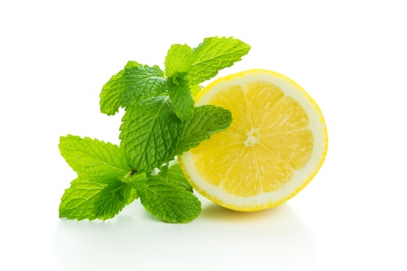 peppermint: Yellow lemon with mint isolated on white background Stock Photo