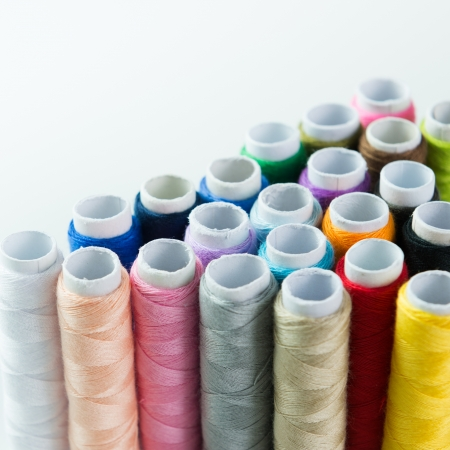 nylons: Close-up image of colourful threads isolated on white background