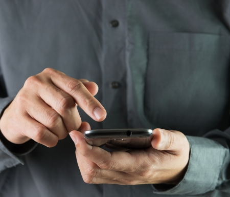 Businessman is using smartphone for communication and works Stock Photo
