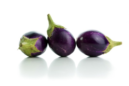 brinjal: Three eggplants in a row isolated on white background