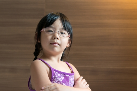 spectacle: Portrait of little Asian kid with glasses indoor