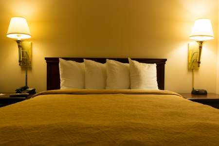 Inter of a queen size bed hotel bedroom Stock Photo - 23308728