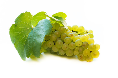 raisins: Close up of white wine grapes over white background Stock Photo