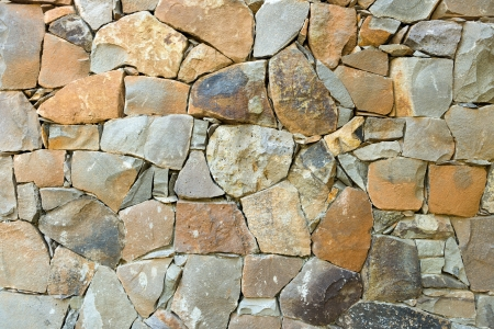 Close up of stone wall use for construction business and designer photo