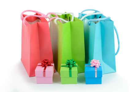 gift bags: Multicolor gift bags and gift boxes on white background Stock Photo