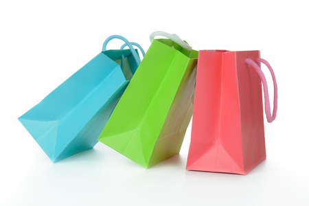 Red, green and blue gift bags isolated on white background photo