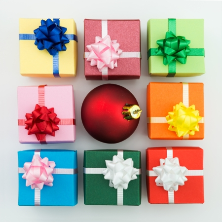 Multi color gift boxes and Christmas bauble photo