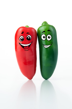 pimento: Red and green chilli pepper with smiling face Stock Photo