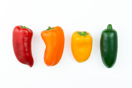 red jalapeno: Red, orange, yellow and green jalapeno pepper in a row
