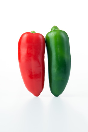 red jalapeno: Red and green jalapeno hot peppers isolated on white background