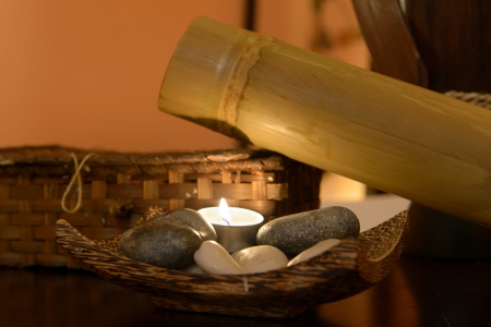 Spa element consisting of spa stones, candle and bamboo photo