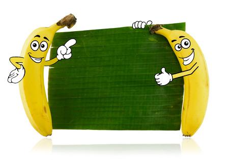두 개의 바나나 만화 캐릭터는 녹색 잎 옆에 서