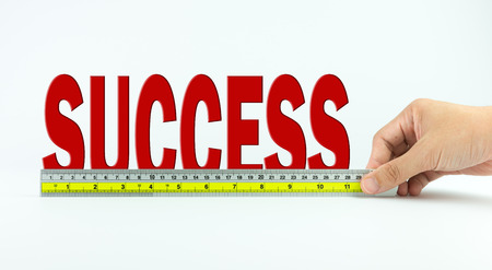 accomplishes: Measure of success concept using ruler Stock Photo