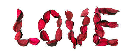 Word love made with red rose petals on white background