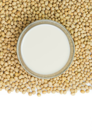 soymilk: Soymilk and soy beans over white background