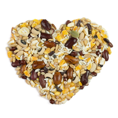 Close up of mixed grains in heart shape photo
