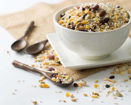 Heap of mixed grains on bowl over white background photo