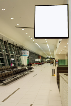Blank white signboard in boarding room at airport terminal