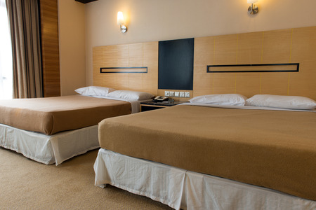 double beds: Interior of double beds in hotel bedroom