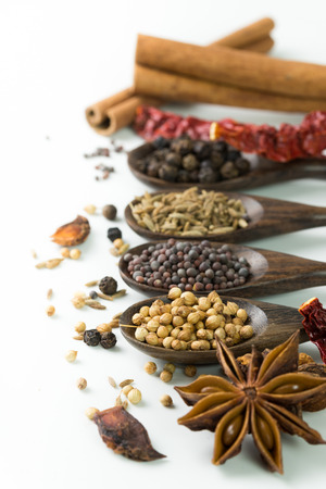 An assortment of different spices for cooking photo