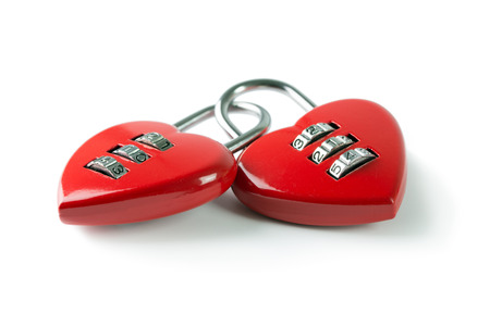betrayal: Two red heart shape combination padlock linked to each other