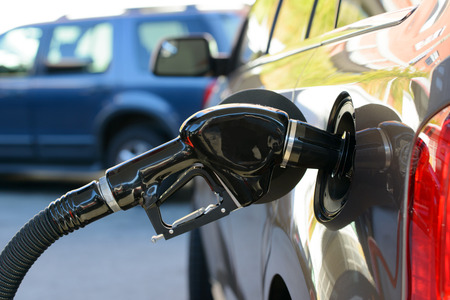 fuelling pump: Close up of gas filling at petrol station Stock Photo