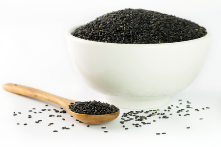 black seeds: Close up of black sesame in bowl and wooden spoon