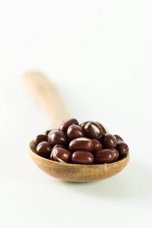 adzuki bean: Close up of red bean on wooden spoon