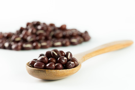 Close up of red bean on wooden spoon