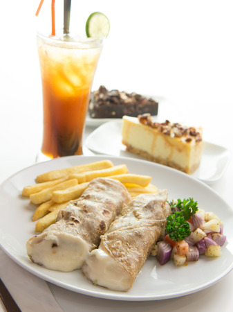 low cal: Close up of chicken roll served with chips and vegetables