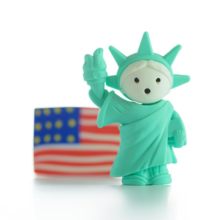 Miniature Statue of Liberty with US flag photo