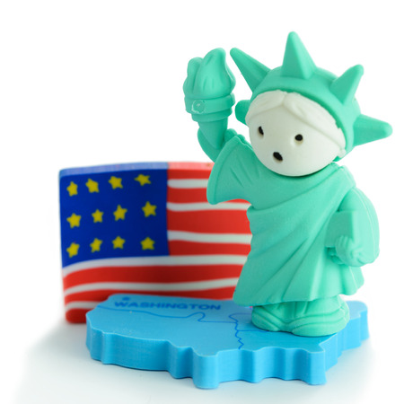 Miniature Statue of Liberty with US flag Stok Fotoğraf