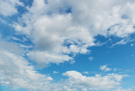 skyscape: Bright blue sky with puffy white clouds Stock Photo