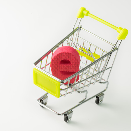 e retailers: Online shopping concept with letter e inside miniature shopping cart