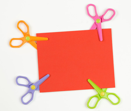price cut: Price cut concept using plain card with scissors over white background