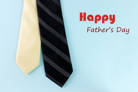 Happy father s day text with tie in light blue background photo