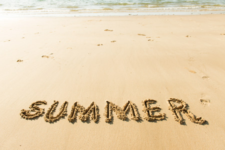 Word summer on the white sandy beach photo