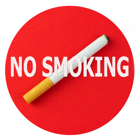 No smoking sign message with burning cigarette photo