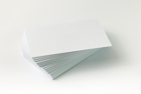 stack of business cards: Close up of plain business cards on white background Stock Photo