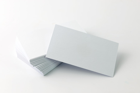 Close up of plain business cards on white background Foto de archivo