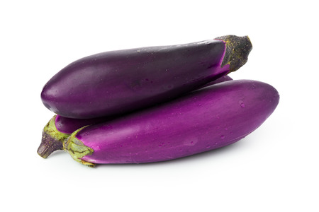 brinjal: Close up of three eggplants over white background