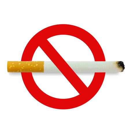 Burning cigarette on no smoking sign over white background photo