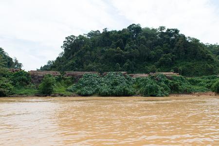 unsustainable: Timber logging camp along Sarawak Rejang river, Malaysia